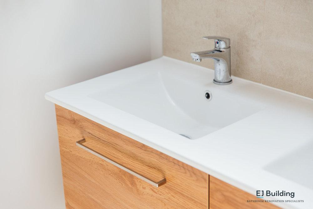 Double basin in wall hung vanity. Auckland based bathroom renovation company.