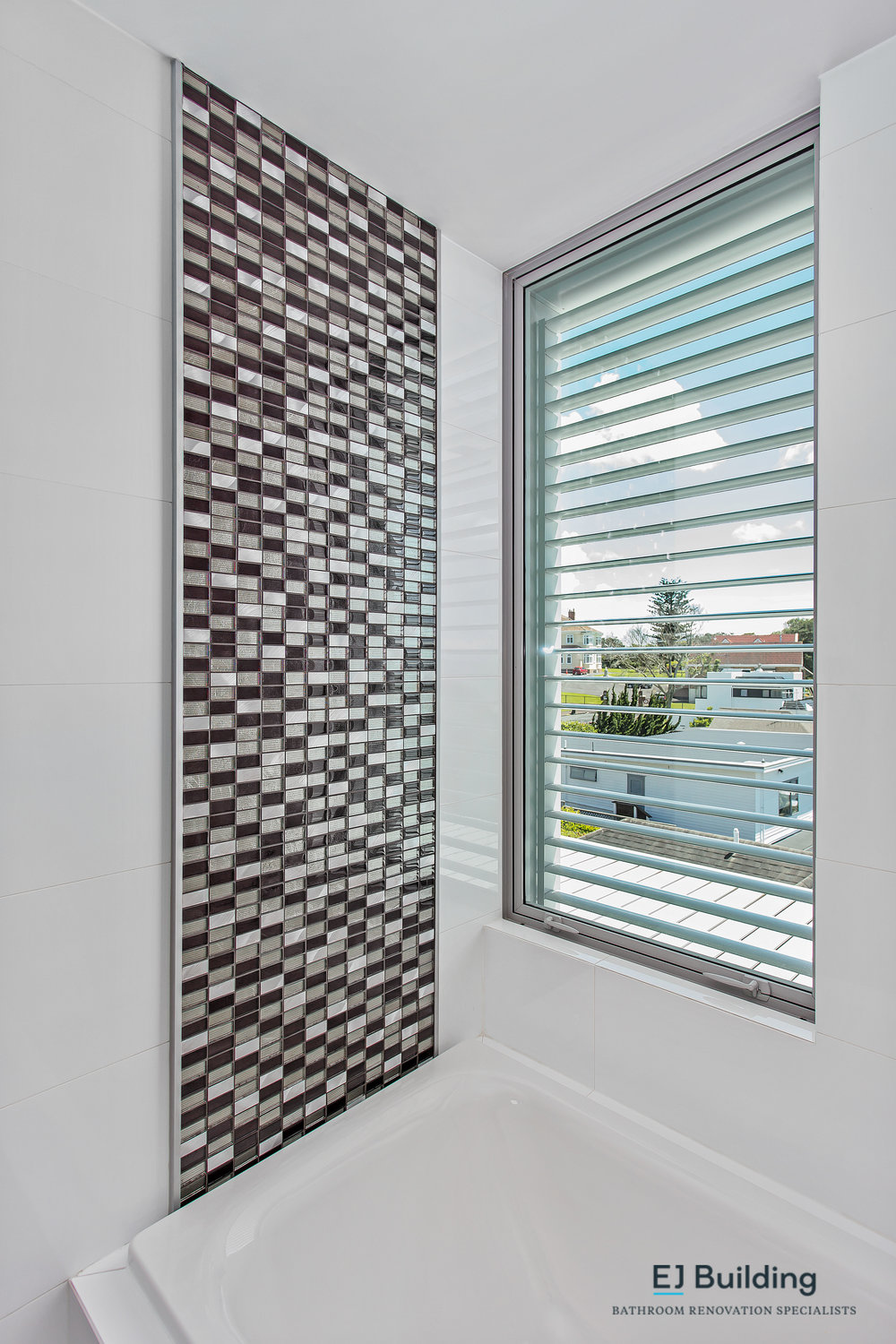 louvered window for renovated ensuite in Auckland, mosaics / mosaic tiles to catch the sun light.