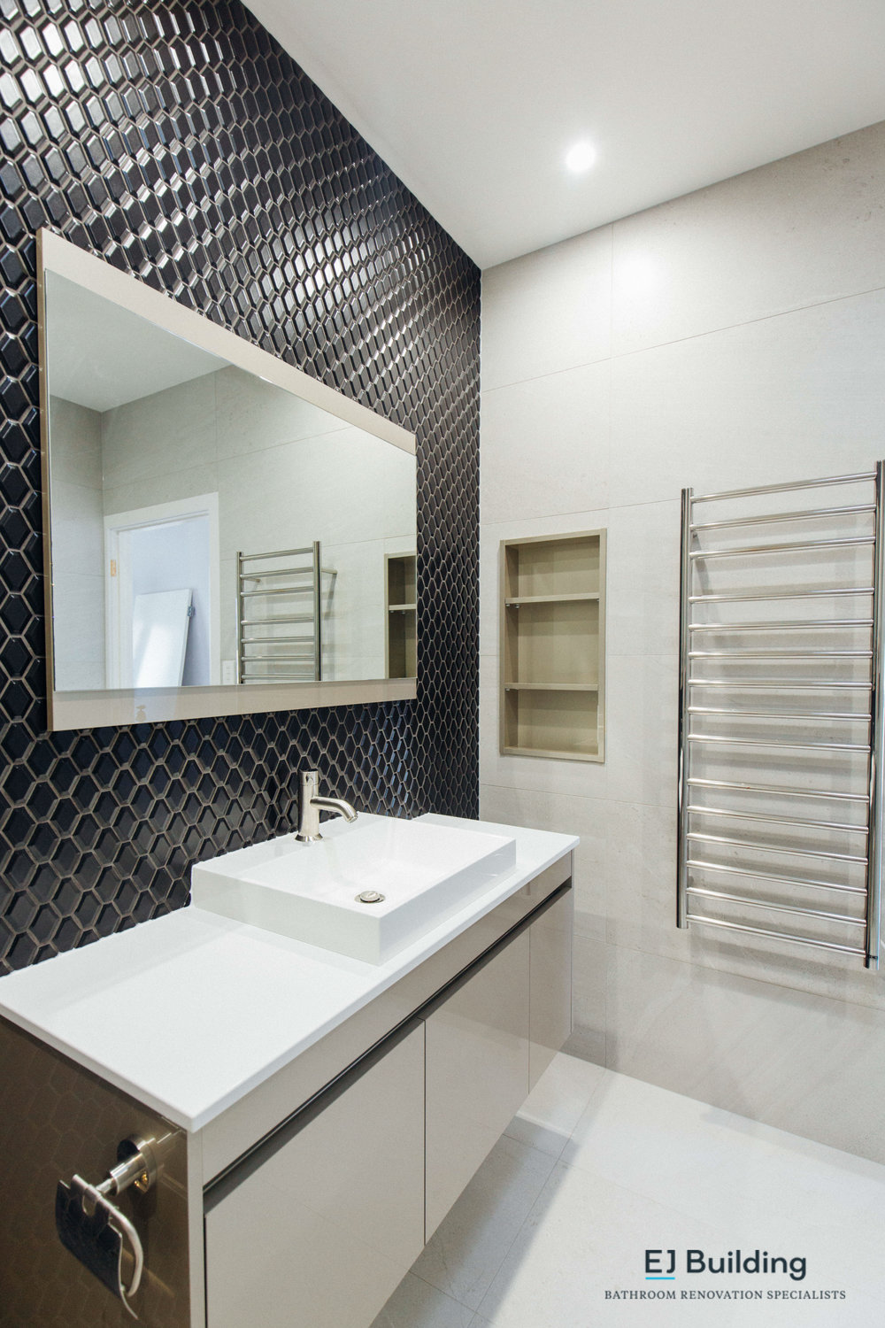 Great idea is to mount you toilet roll holder to your vanity and keep the tiled walls looking nice and clean.