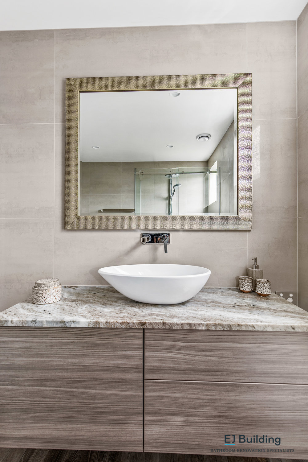 Bathroom renovation, interior designer, surface mounted bowl on custom made bathroom vanity and matching mirror.