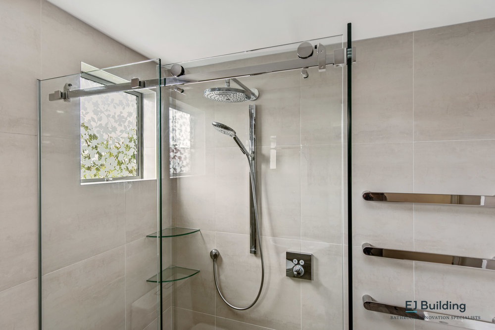 Ellerslie renovated bathroom, showing frameless sliding shower. Bathroom renovation ideas.