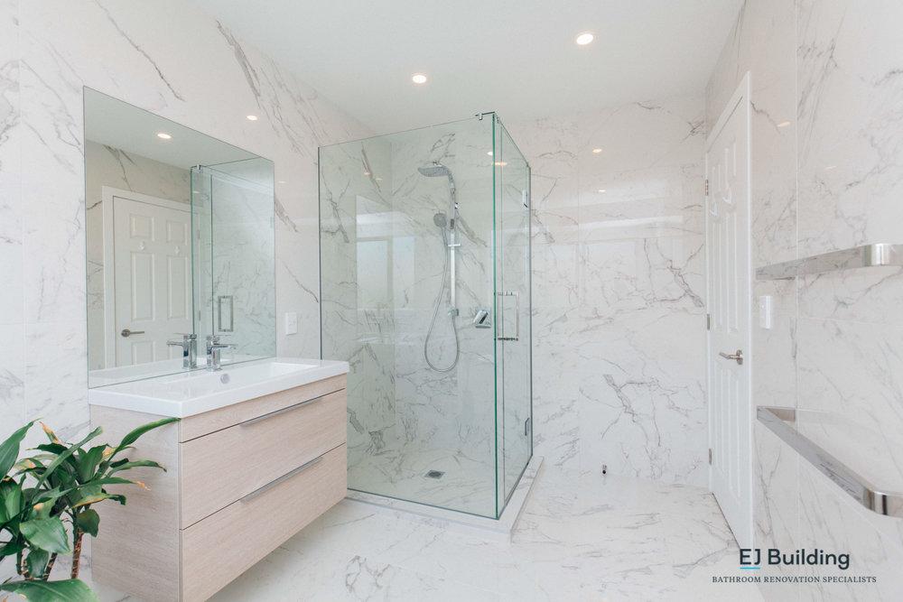 Frameless glass shower, shower waste, timber vanity, bathroom mirror. bathroom ideas. Auckland