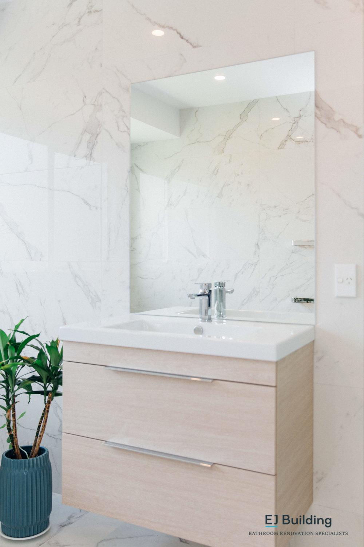 Timber bathroom wall hung vanity.