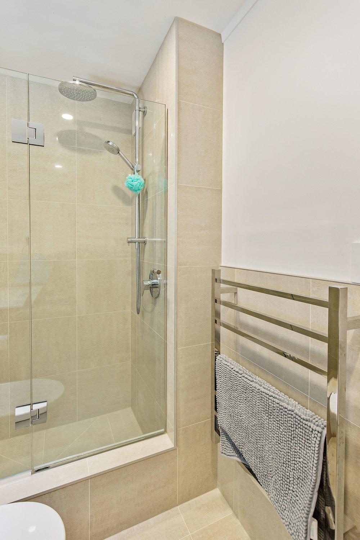 Bathroom renovation ideas, half high tiles, double shower head, heated towel rail. bathroom ideas.