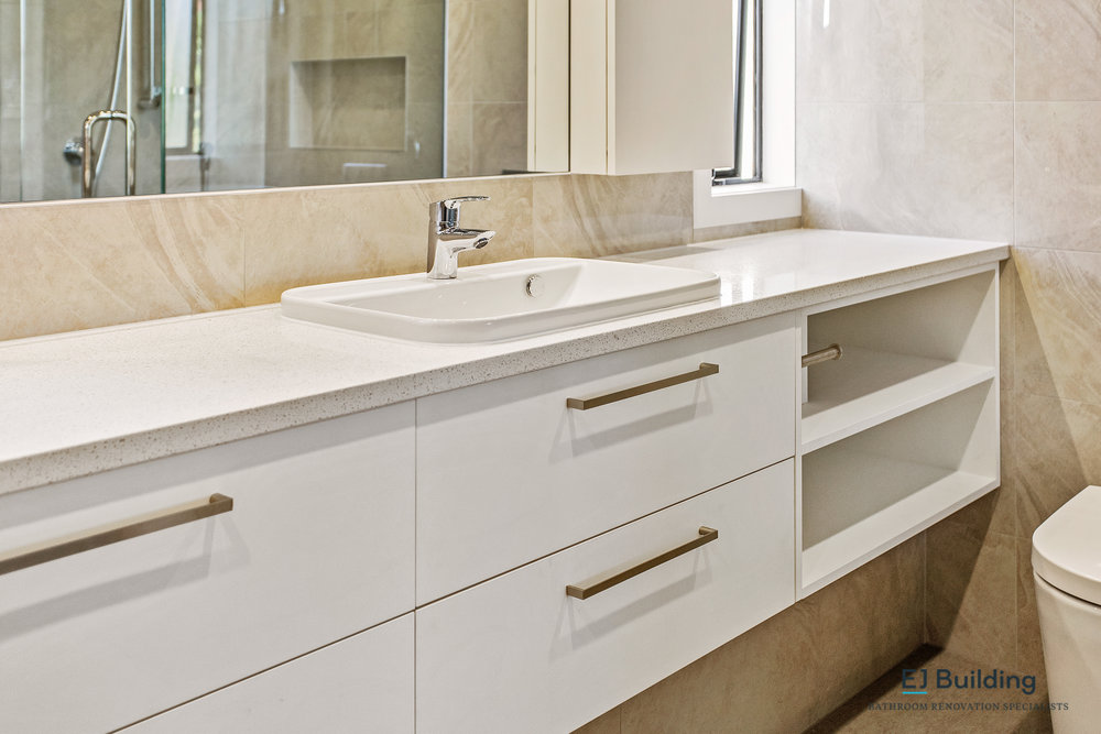 Auckland Bathroom renovators. Custom vanity with open shelving to keep bathroom towels.