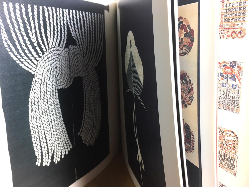 Between the pages of the exhibition catalogue for Japan 2001 National Museum of Scotland:Serizawa: Master of Japanese Textile Design