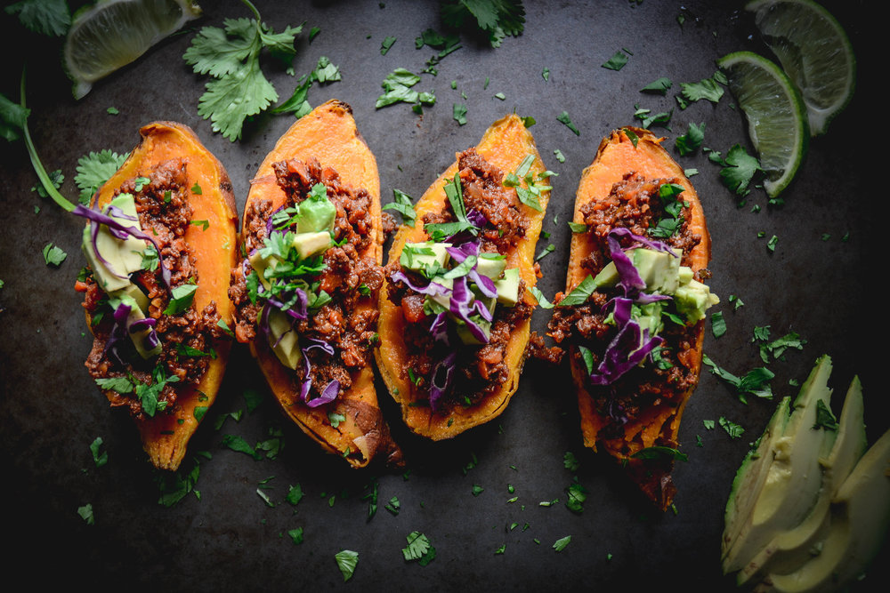 sweet potato halves stuffed with chili and chopped parsley