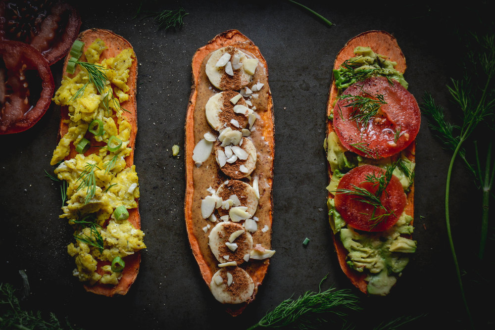 sweeet potato toast with eggs, bananas and tomatoes, dill as garnish on tray