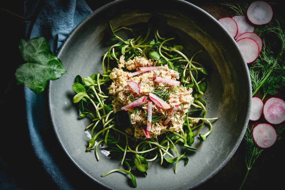 tuna salad over greens with radishes and dill