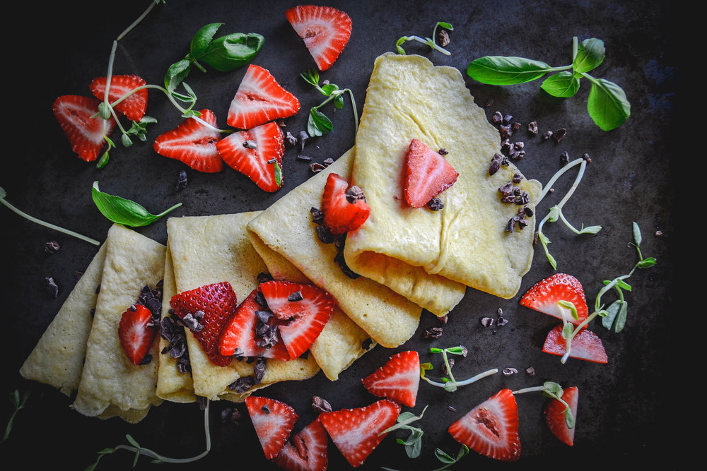 folded crepes, strawberries