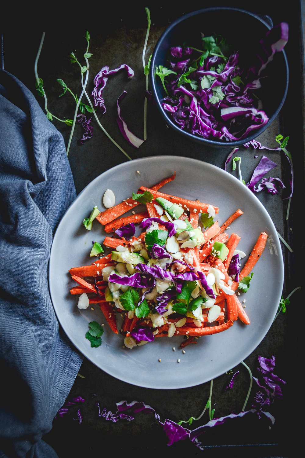Cumin roasted carrots with avocado, tahini dressing and sesame seeds