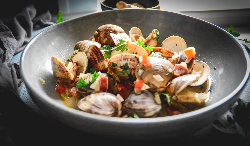 Chorizo with little neck clams and pepper broth