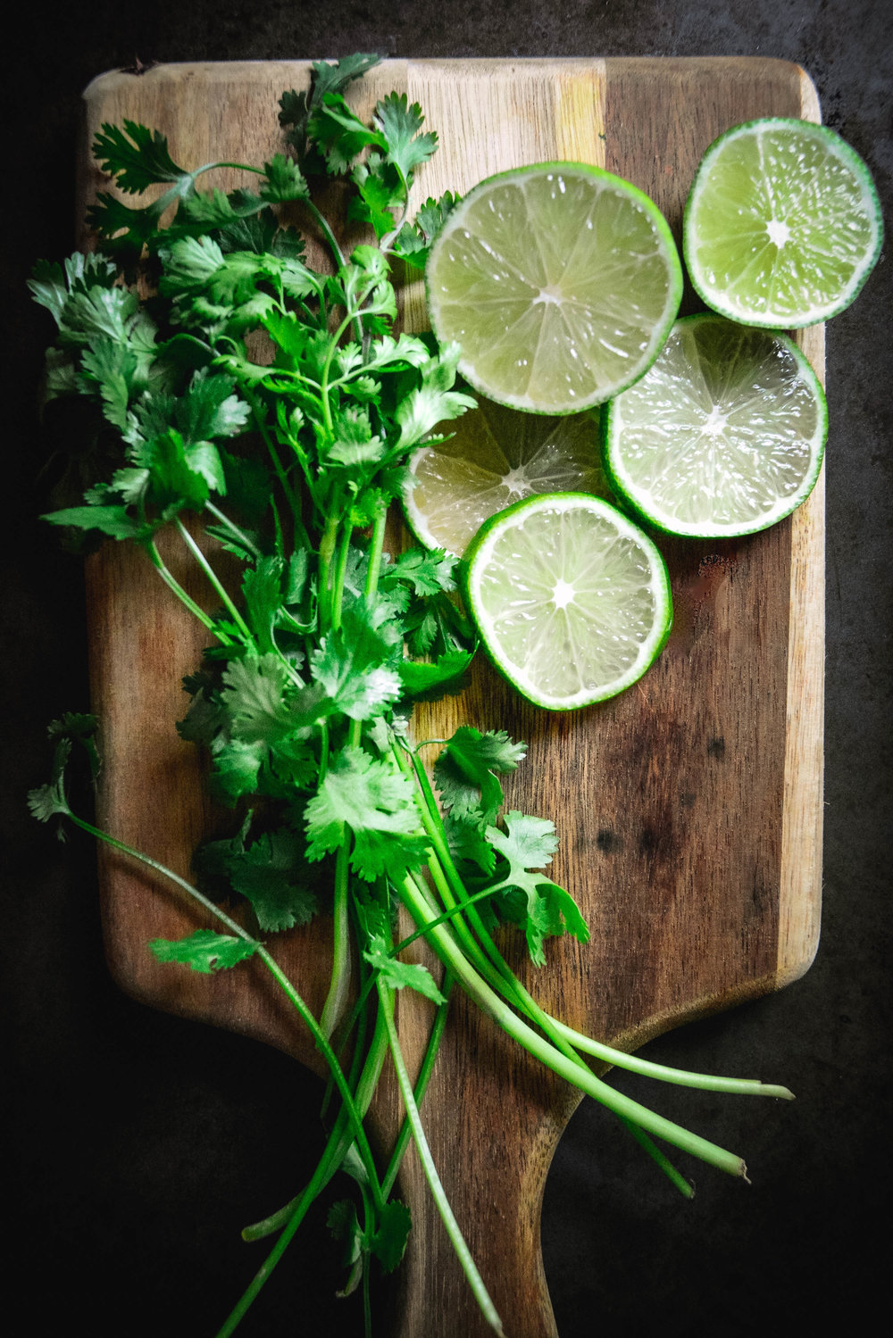 cutting board lime slices and cilantro