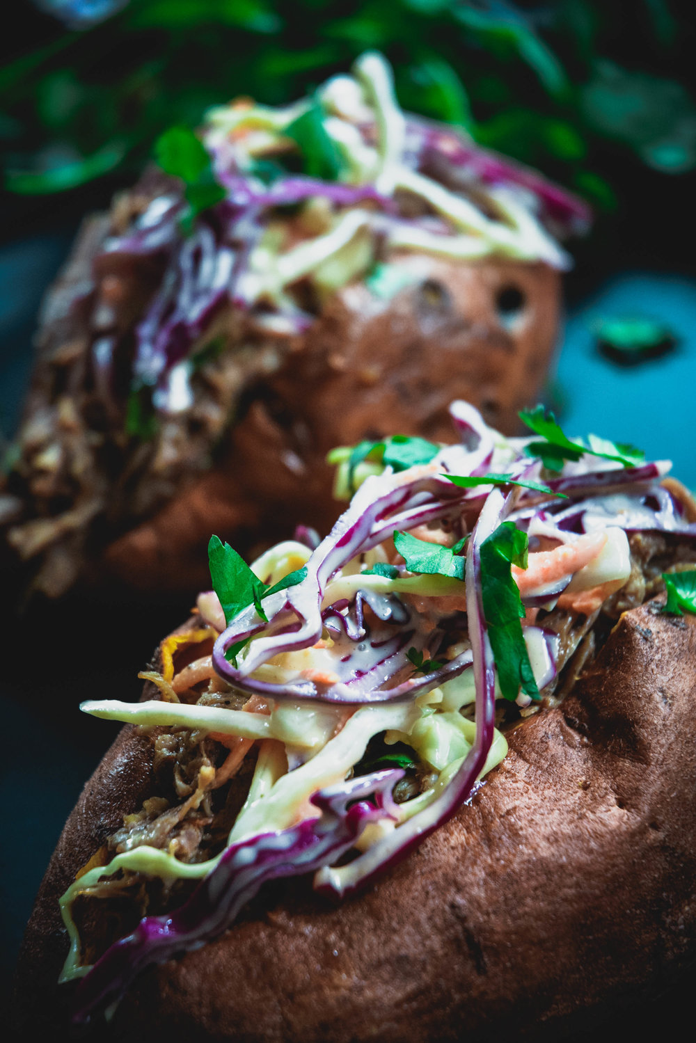 sweet potato stuffed with pulled work and coleslaw