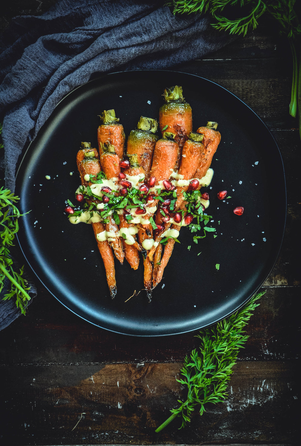 roasted carrots with orange tahini dressing and pomegranate