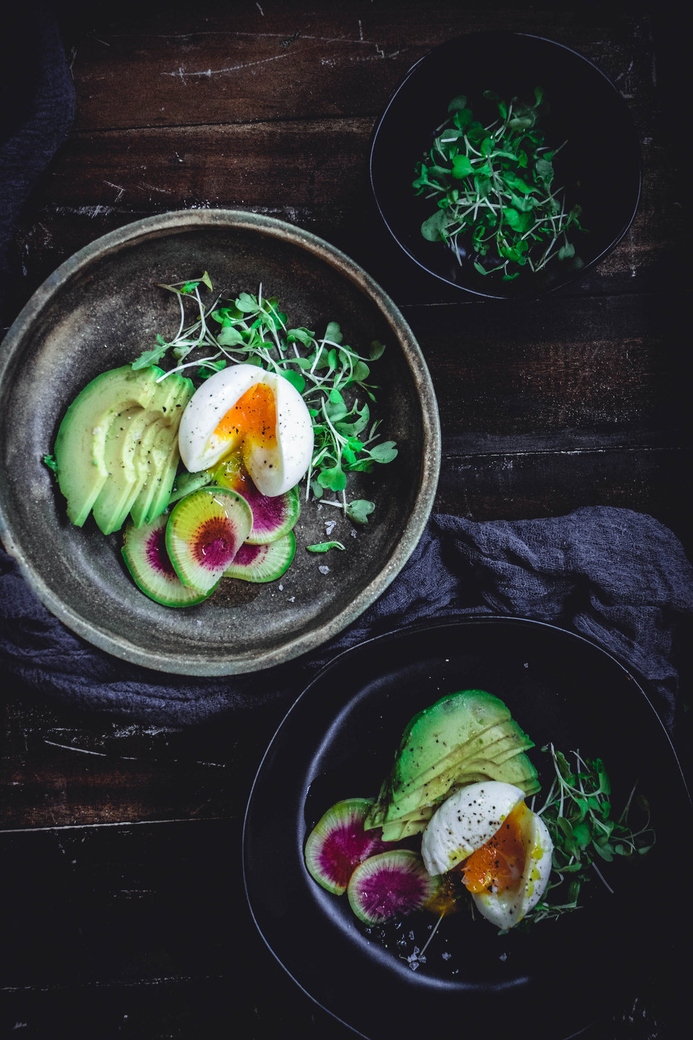 soft boiled eggs with watermelon radish, avocado and greens