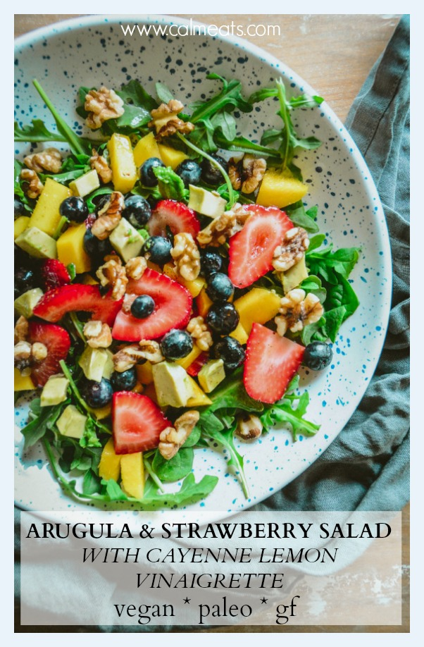 Here's a simple refreshing arugula and strawberry salad with blueberries, mango and avocado. It's quick to make and perfect for a warm spring or summer day. It's vegan, paleo and has a whole 30 option. #vegansalad, #paleosalad, #whole30salad, #veganlunch, #calmeats, #glutenfree, #dairyfree #paleo #simplesalad #easysalad #summersalad #freshsalad