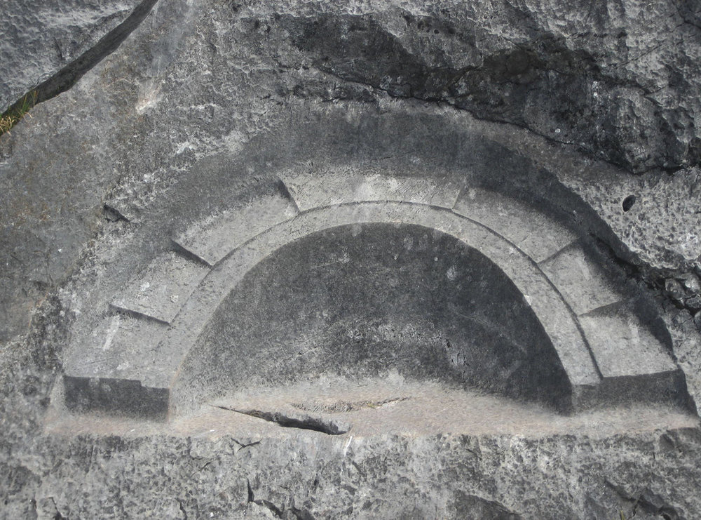 """Quillarumiyoc - The Temple of the Moon.   The  Temple of the Moon  is an  Incan  ceremonial temple on  Huayna Picchu  near  Machu Picchu , in Peru. The site is made up of stone masonry and an open-face, shallow cave. In the center of the cave is a throne carved out of rock. Beside the throne are steps that lead deeper into the cave. It is thought that the caves were used to hold mummies. The Temple of the Moon dates back 1500 years and was only rediscovered in 1936.  The Temple of the Moon consists of three structural components: an overhanging cave with superb stonework, a very tall double-jamb doorway beyond, and farther beyond, several structures including one that again uses a cave. The  stone work  in the Temple is said to contain the three planes of the  Incan  religion to be depicted: the  Hanan Pacha  (the heavens, or world of above), the Kay Pacha (the earth, or physical life), and the Ukju Pacha (the underworld, or world of below), represented respectively by the condor, the puma, and the  snake . The temple also boasts niches and fake doors inserted in the stones, with an enormous 8 meter high by 6 meter wide entrance. The premises are rectangular with the rocks of the mountains as walls. Its three doors are 1.60 meters high (in the front) and 1.00 m high (at the sides). Inside, there are six trapezoidal niches. The """"temple"""", strictly speaking, consists of a major platform supporting a building which is raised 5 meters above the ground, with an 8-meter-high entrance. Huaca de la Luna (Temple of the Moon), contains 6 levels, built on top of the other during a 200-year span.  The purpose of building of the Temple is not exactly known. Keeping in mind that caves, like springs, were thought to be entrances for gods, they believe the Temple's purpose was to be a place of worship to the Gods.  There is a theory that it must have been a royal tomb, place of worship and look-out post. Some believe that this was a place for sacrifices, because the structure has be"""