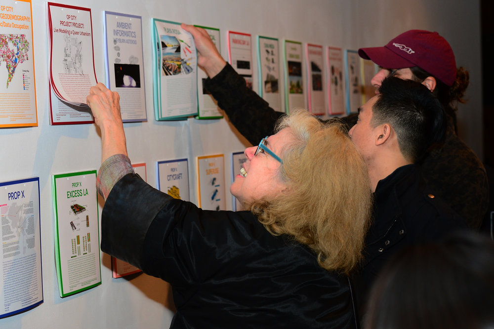 Visitors of opening night assembling their own catalog of cityLAB's work over the past 10 years.