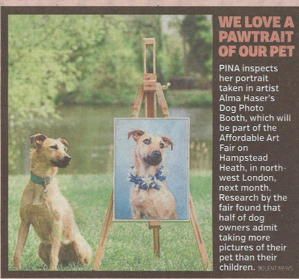 Pina with her portrait in Hampstead Heath, helping promote The Dog Photobooth at the Affordable Art Fair in May, in the London Metro.