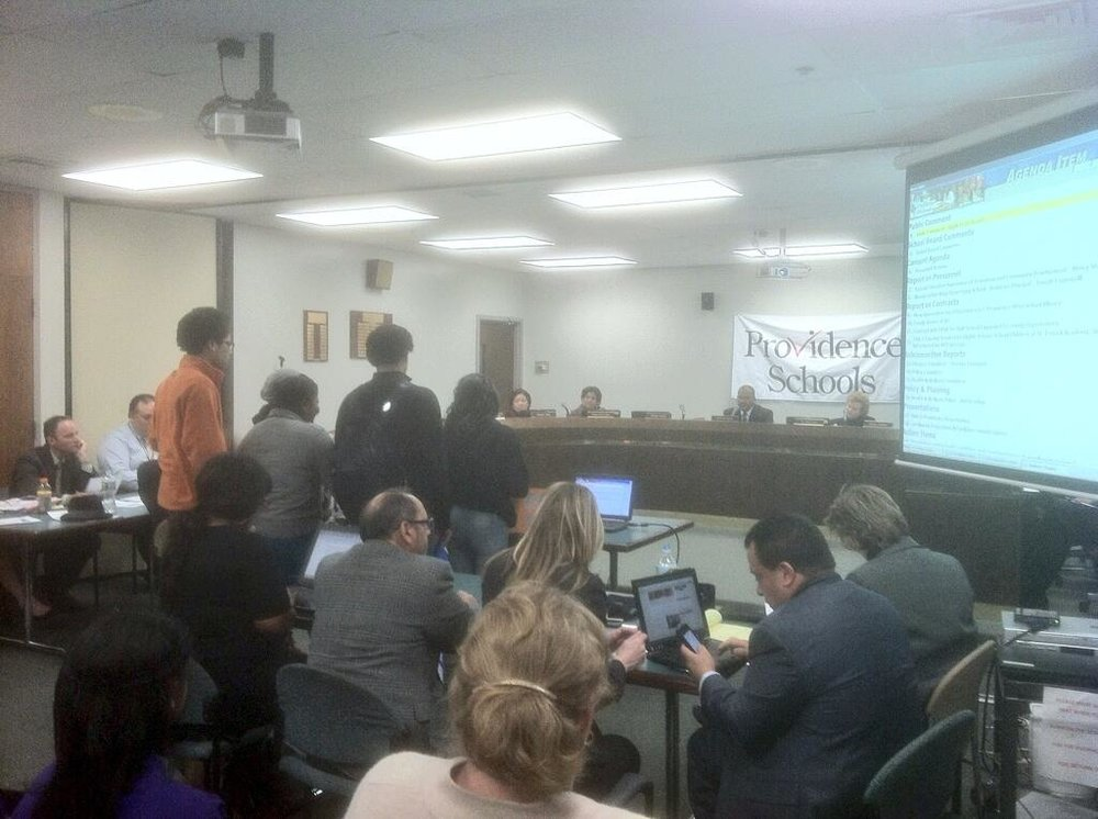 Students testify at a Providence School Board meeting.