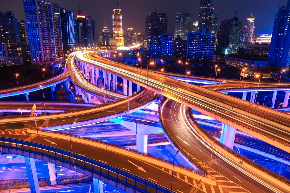 stock-photo-shanghai-elevated-road-junction-and-interchange-overpass-at-night-345719297.jpg