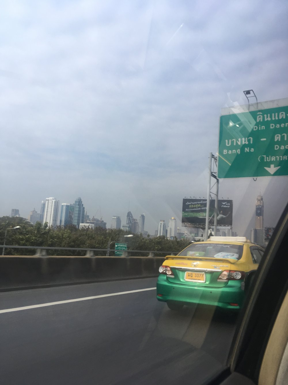highway from airport to hotel, check the skyline