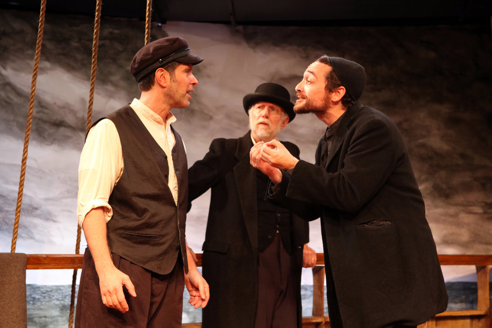 Ben Prayz, as Samuel, argues with Sean Singer as Jeff Fader listens The Learning Play of Rabbi Levi-Yitzhok, Son of Sara, of Berditchev, Castillo Theatre, October 2011 Photo: Ronald L. Glassman