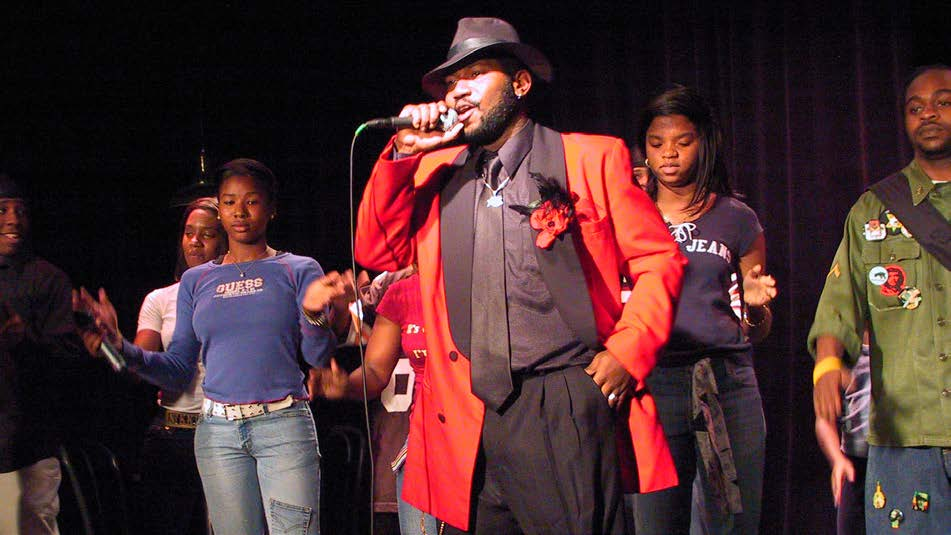 Antoine Joyce, performing as the MC with ensemble in the All Stars Hip-Hop Cabaret #1, a devised production directed by Joyce and Dan Friedman at the Castillo Theatre, March 2004. (Photo by Ronald L. Glassman)
