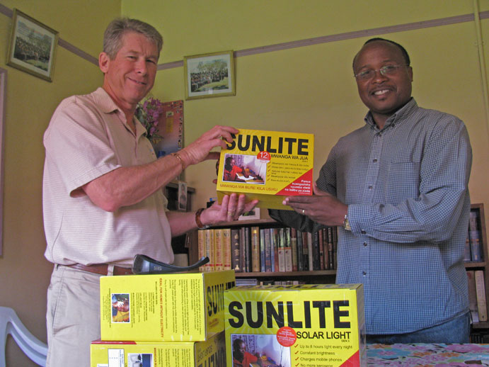 John and Pastor George with solar lights for Manna Bible Institute