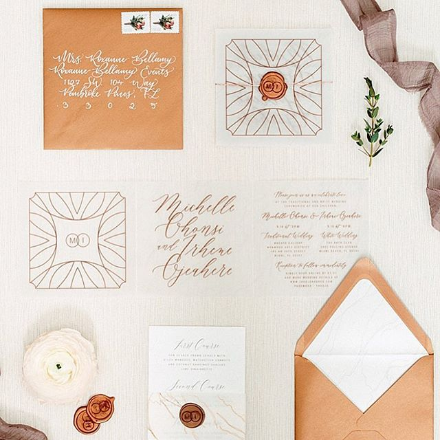 Love this clean design I created with copper + marble details 💕 Envelope Calligraphy by @inkwellington • Script font by • @elizagwendalynink • Captured by @erikadelgadophoto • Styling by @roxannebellamy • Featured on @insideweddings #madedivine #weddingstationery #vellum #waxseal