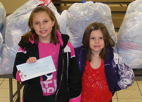 Abigail and her sister bring donations to Joseph's House