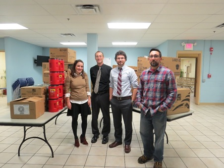 MHS Lift, Inc. employees Courtney McNulty, Joe Perry, Steve Bosco, and Tom O'Hara drop off wish list supplies to Joseph's House