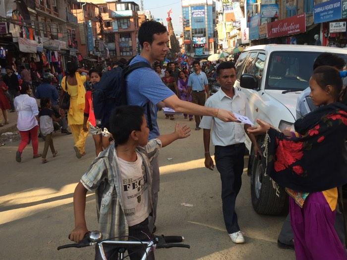Christian Parks distributes Gospel material at a Hindu Festival in Kathmandu.