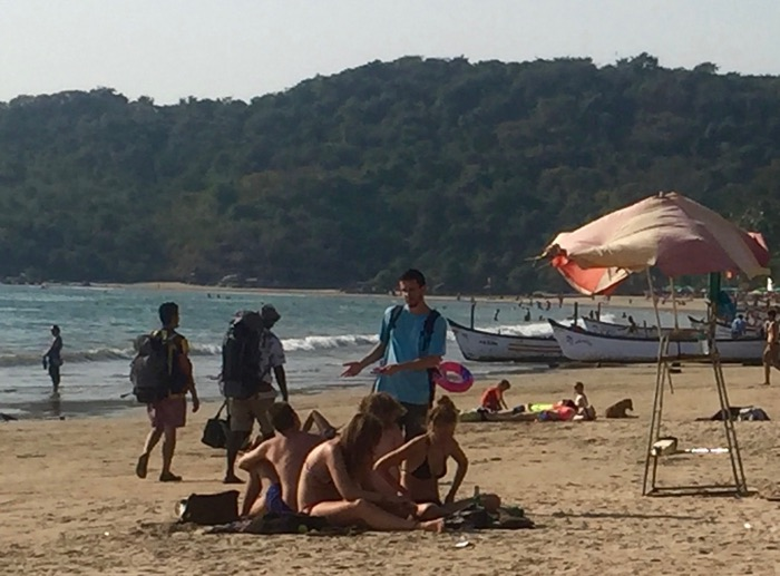 Christian speaks with Israelis about their Messiah on the beach outside Goa.
