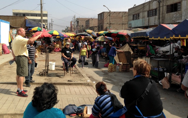 Brother Jon Lane preaches in a Lima fish market.