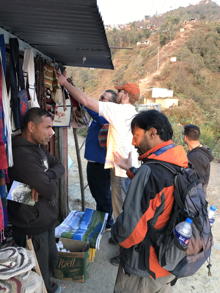 Reaching a shopkeeper in Pokhara.JPG