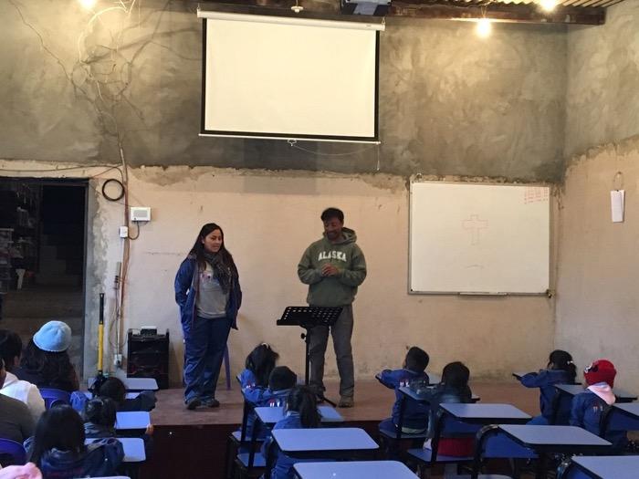 Bishnu preaches to the kids at Heart of Christ in Caja de Agua.