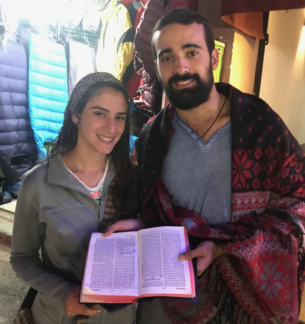 Israeli trekkers on the streets of Kathmandu react with amazement when shown a Bible that has been translated into the Nepali language.