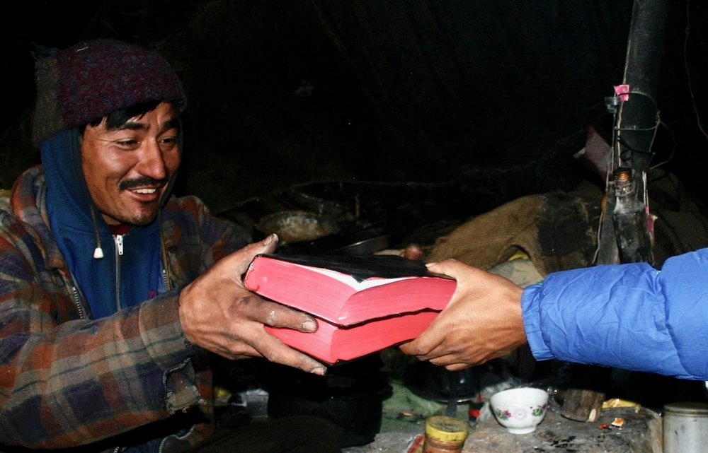 Two yak herders who had believed the Gospel were so happy to finally have personal copies of the Holy Scriptures delivered to them in their remote corner of the earth (2006).