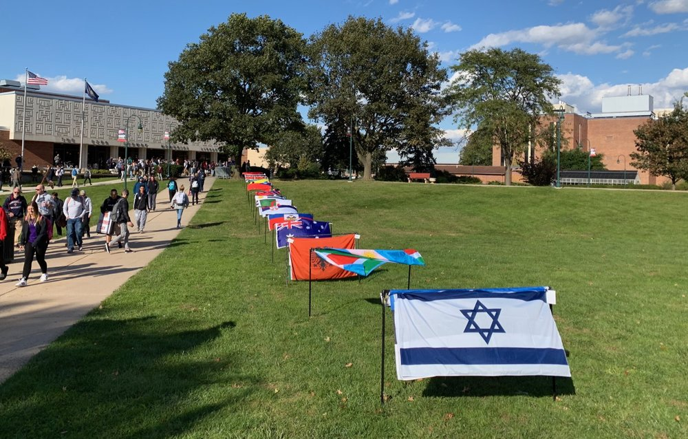 A display of international flags on a liberal college campus actually featured the Flag of the Modern State of Israel, a pleasant surprise.