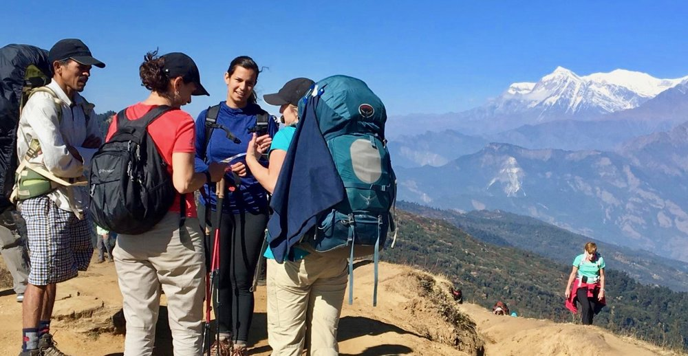 Mindy Trent shares with some Gentile backpackers atop Poon Hill in Central Nepal.