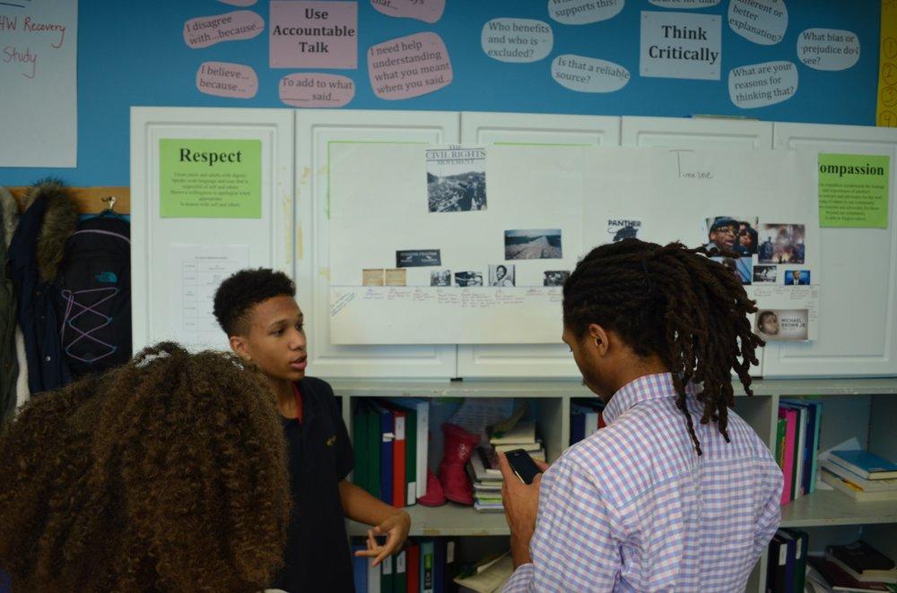 Eddie explaining his timeline to teachers