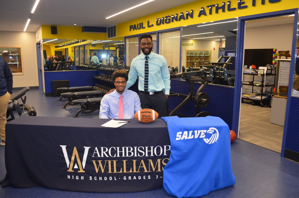 Oronde and Mr. Joazard at Archbishop Williams when Oronde got signed to Salve Regina to play football.