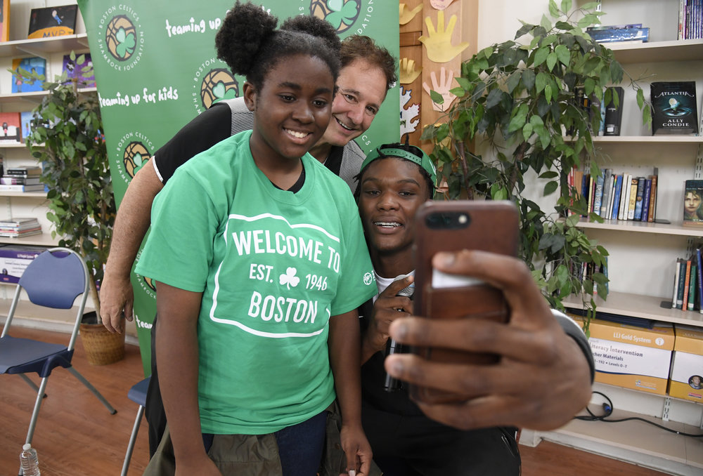 Robert Williams, the 2018 Celtics Rookie, taking a selfie with Ashanti and Stephen Pagliuca