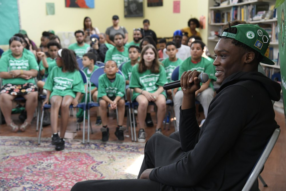 Robert Williams, the 2018 Celtics Rookie, speaking to students during an assembly