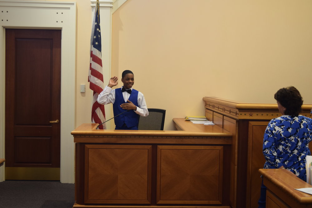 Takari being sworn in