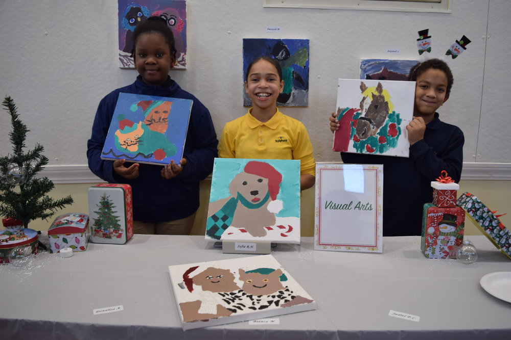 Donalisa, Sophia and JJ showing off their art
