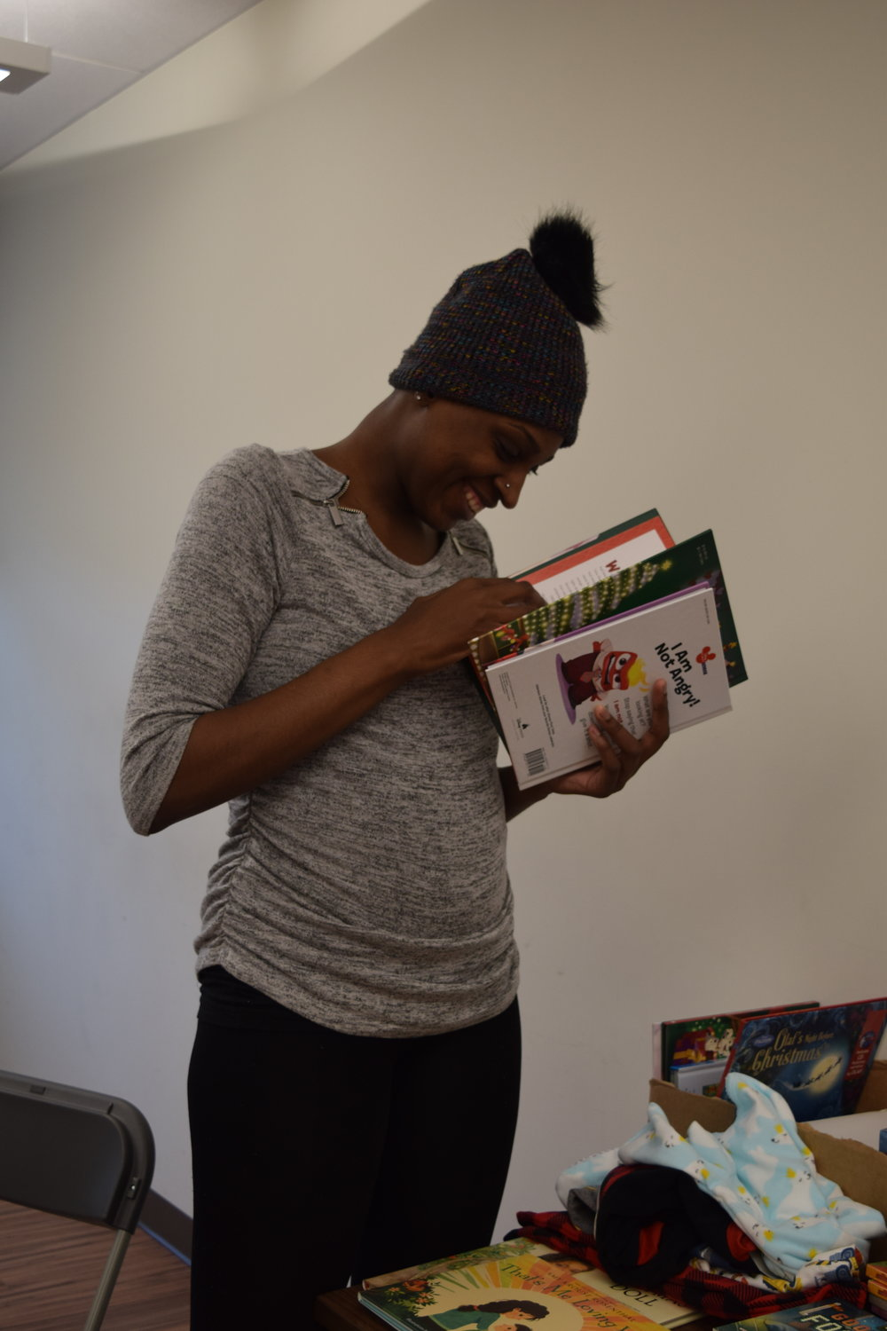 Jasmine leafing through the books for her kids