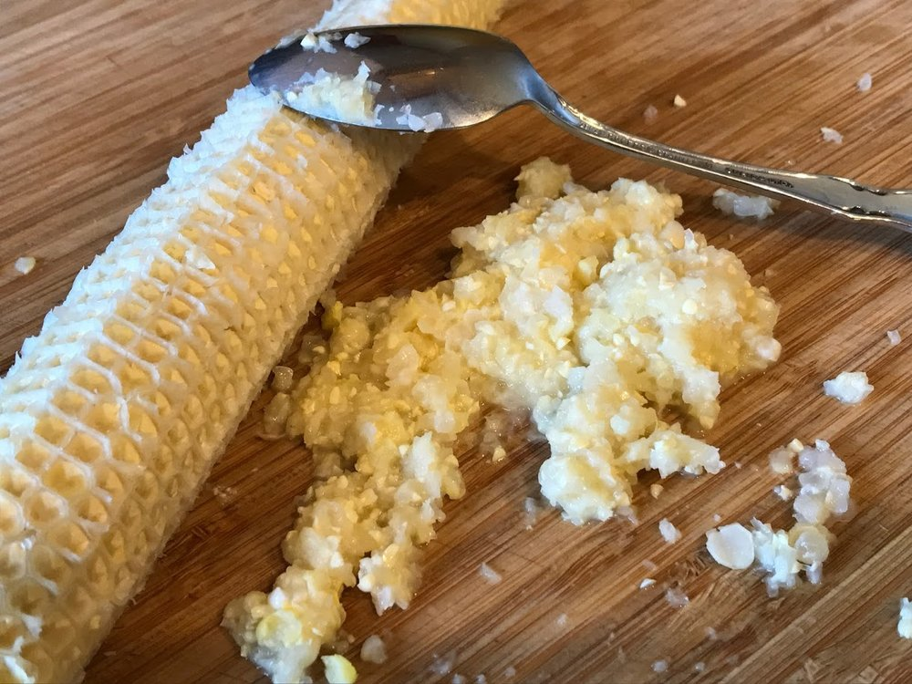 Corn pulp scraped from cob after kernels have been cut off.